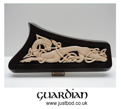 Hand carved lime and bog oak animal and knotwork celtic design