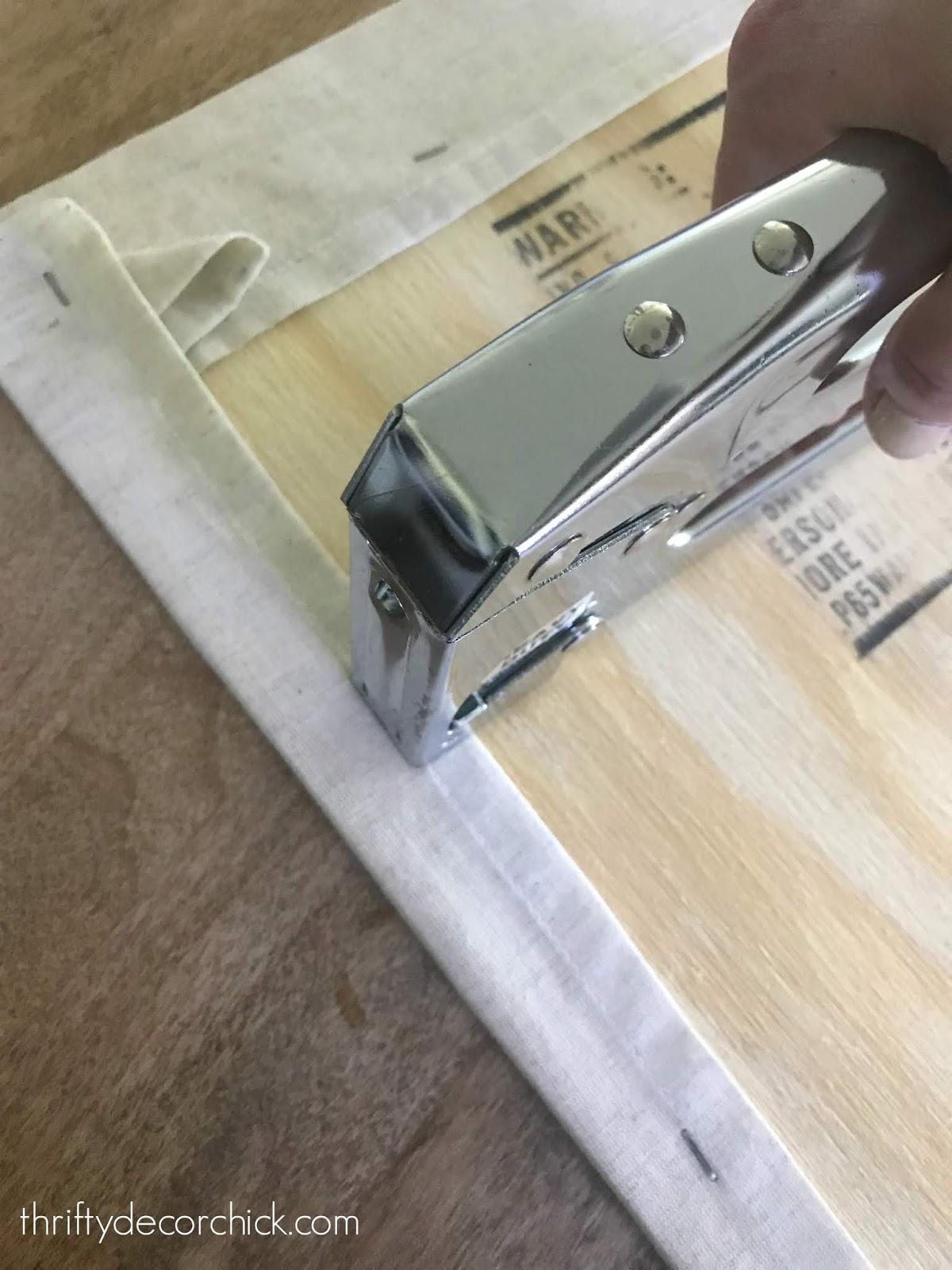 How to staple fabric around wood