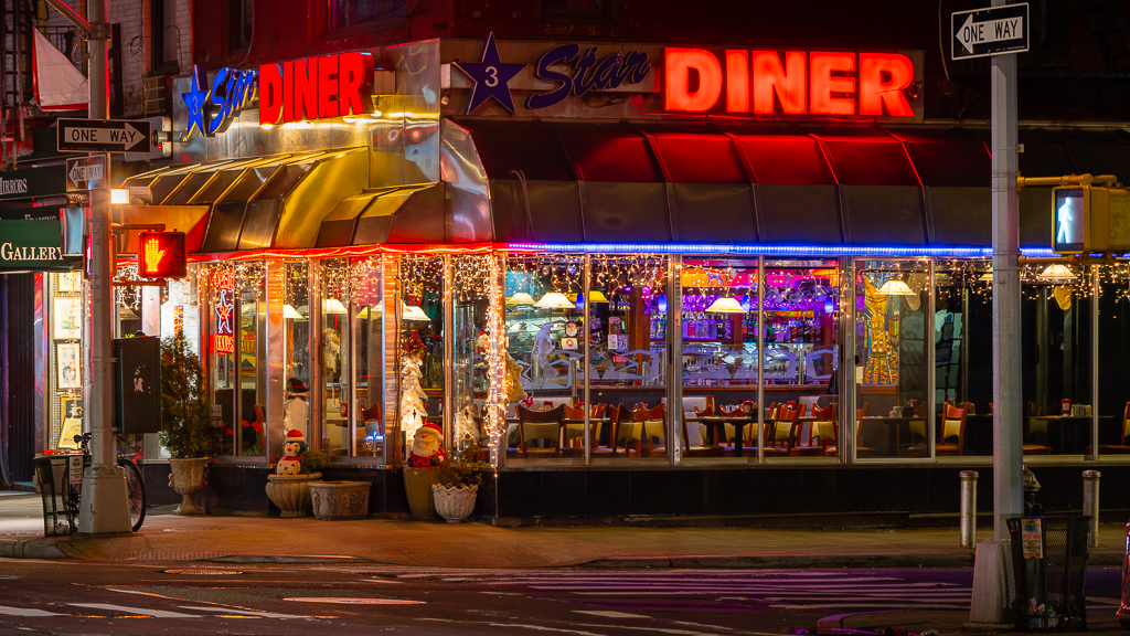 a photo of a new york city diner decorated for christmas