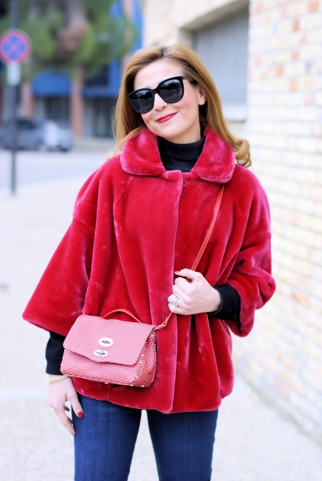 How to wear a red faux fur jacket on Fashion and Cookies fashion blog, fashion blogger style