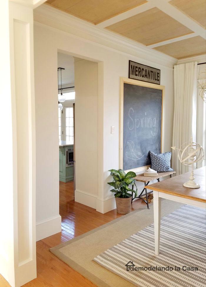 room white trim, chalkboard, mercantile sign and bench
