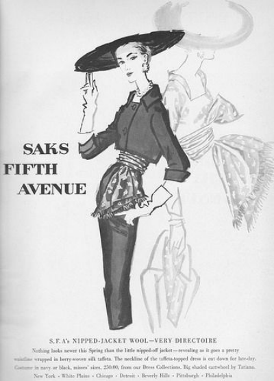 Magazine ad for Saks Fifth Avenue showing woman in suit with gloves and wide brimmed hat by Tatiana