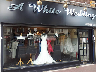 http://www.awhiteweddingshop.co.uk/contact