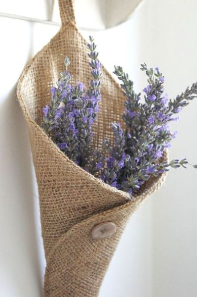 This burlap cornucopia holds lavender flowers and is perfect to hang on your front door