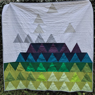 Forest Mountain triangle quilt solids free motion quilting