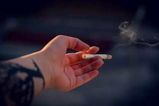 insistence of friend or a young soul who want to rebel love smoking
