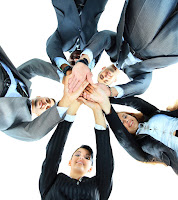 Trabajo en equipo, manos unidas