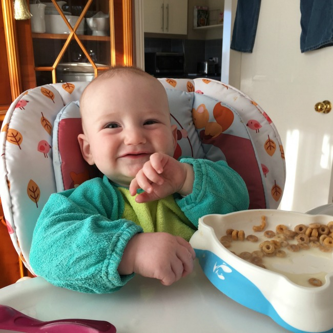 baby-sat-in-high-chair-eating-breakfast