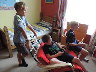 3 boys in a bedroom