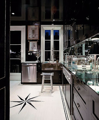 kitchens with black cabinets and mirror back splash