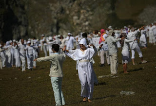 "Followers of the Universal White Brotherhood, an esoteric society that combines Christianity and Indian mysticism set up by Bulgarian Peter Deunov in the 1920s, perform a dance-like ritual called ""paneurhythmy"" in Rila Mountain, Bulgaria, August 19, 2017. REUTERS/Stoyan Nenov (Reuters)"