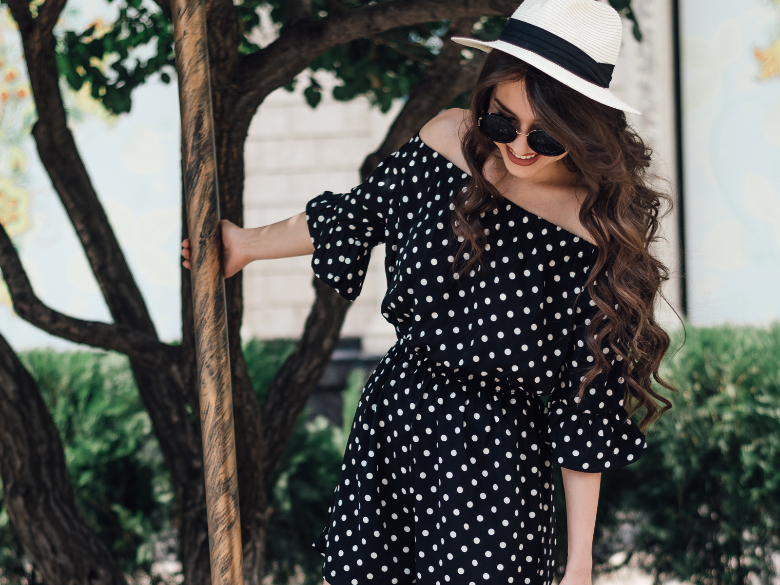 fashion blogger diyorasnotes diyora beta polka dot romper white sneakers asos straw hat backpack new look casual outfit