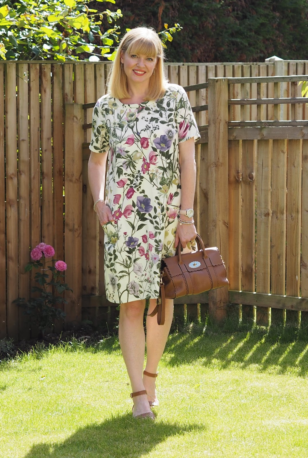 Ethical fashion Braintree botanical floral print dress with tan sandals and Mulberry bag. Over 40