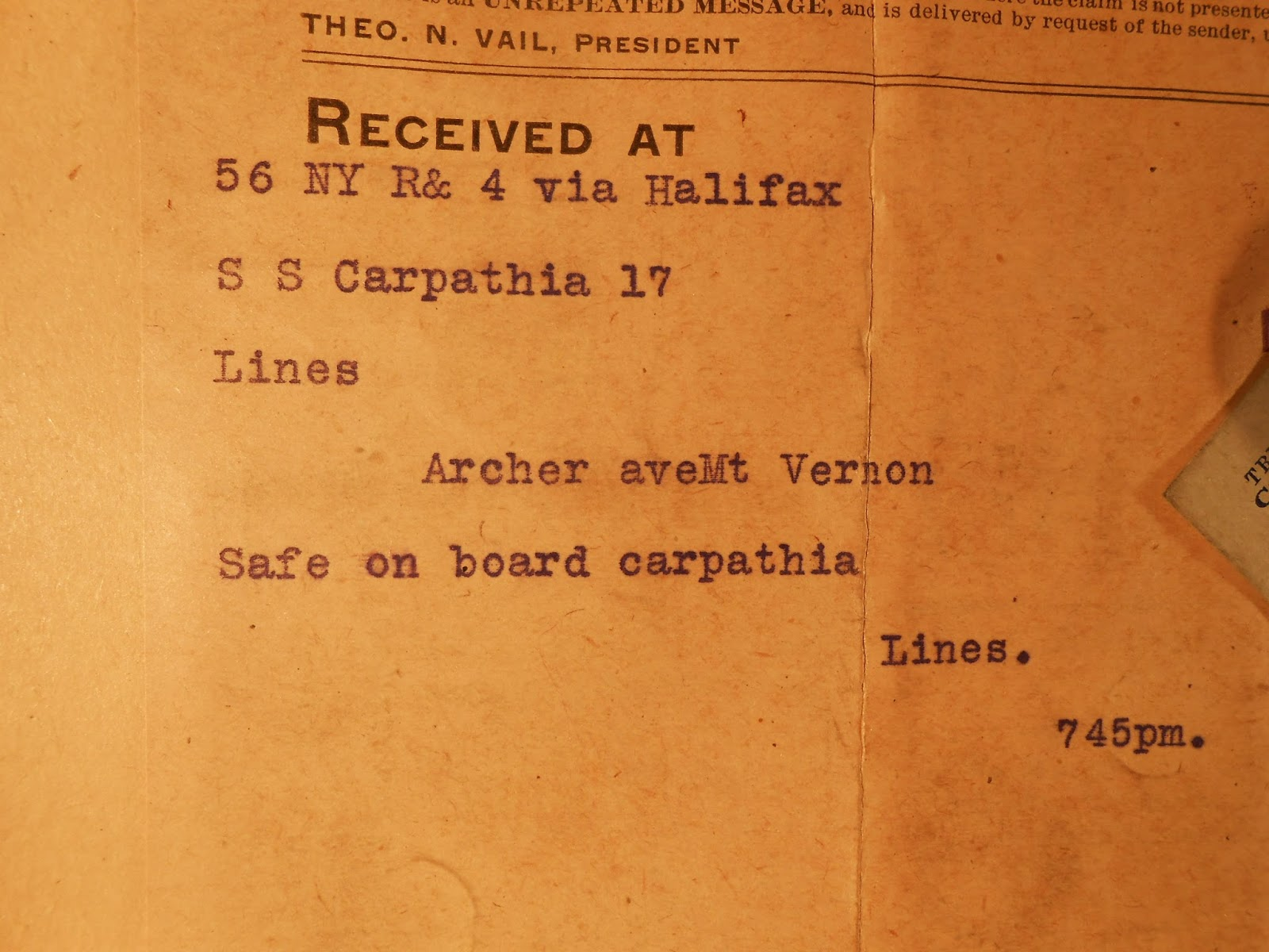 A photograph of a telegram announcing safety onboard the Carpathia.