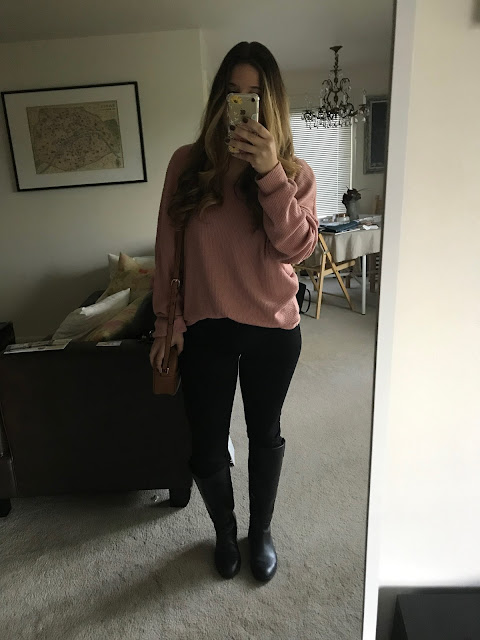 Pink sweater, black jeans, black boots and brown crossbody
