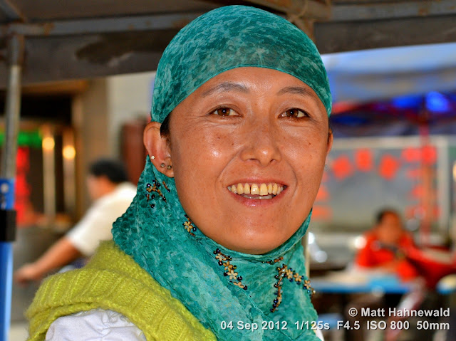 street portrait, headshot, China, Xi'an, Hui Muslims, Hui Muslim woman, headscarf, turquoise hijab