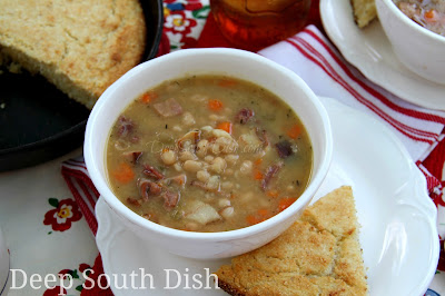 Somewhere between a soup and stew, all thick and creamy and soothing, this full bodied and flavorful pot of white beans is all due to the ham bone.