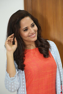 Actress Anasuya Bharadwaj in Orange Short Dress Glam Pics at Winner Movie Press Meet February 2017 (79).JPG