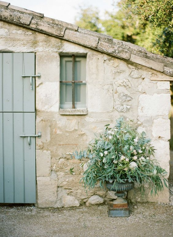 Exquisite rustic weathered stone facade of #Frenchfarmhouse with #sagegreen planked wood #Dutchdoor on Hello Lovely Studio