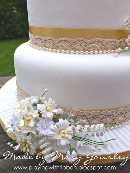 Playing With Ribbon Honey Gold Cream Wedding Cake