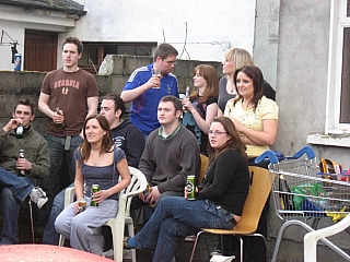 Spectators having some drinks as they watch some gig