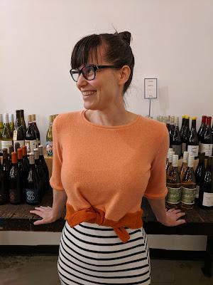 woman wearing a tie-hem shirt, facing the camera