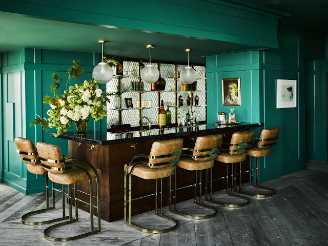 Dramatic teal green lacquer painted walls in bar by Ken Fulk