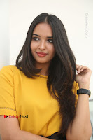 Actress Poojitha Stills in Yellow Short Dress at Darshakudu Movie Teaser Launch .COM 0188.JPG