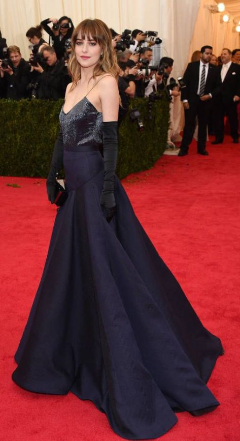 Dakota Johnson in a midnight blue Jason Wu dress at the Met Gala 2014
