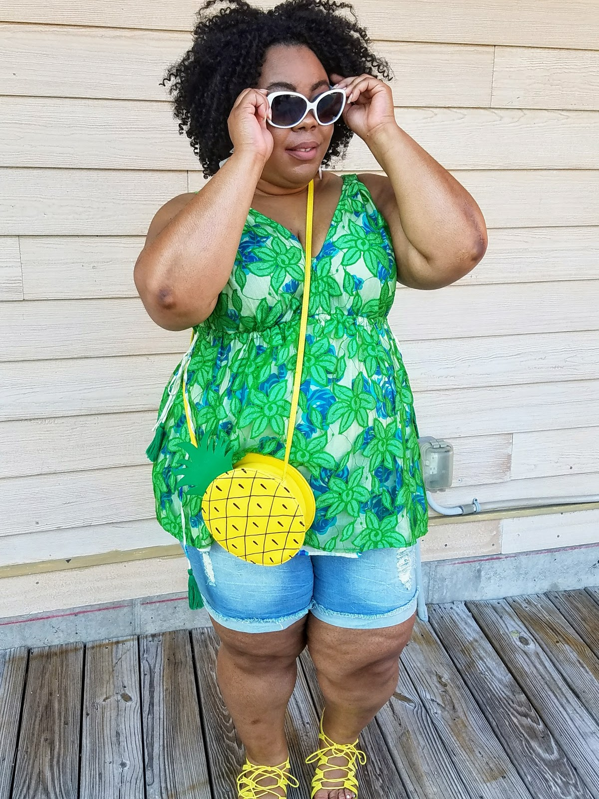 plus size, blogger, florals, shorts, sandals, crossbody purse, natural hair, bold makeup, natural hair, fashion sunglasses
