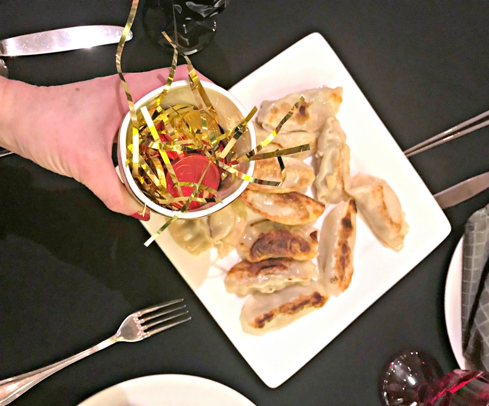 potstickers and gold coins for chinese new year