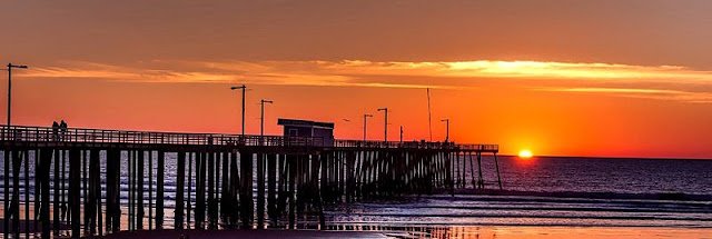 a picture of a pier and golden sunset at Pismo Beach
