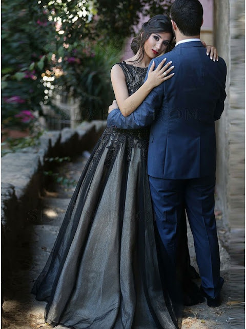 http://www.sevenprom.com/a-line-bateau-floor-length-black-prom-dress-with-lace.html