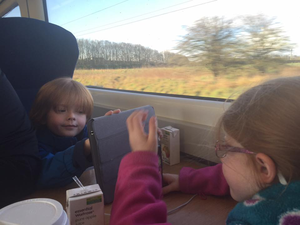 A family day trip to London with Virgin Trains East Coast - kids sitting on a table seat