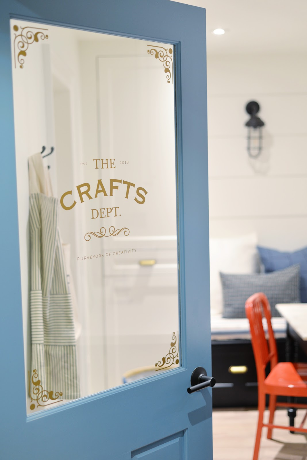 modern coastal craft room | Metrie half lite door with vintage decal | Ramblingrenovators.ca #ProjectCraftsDept | shiplap walls, coastal decor
