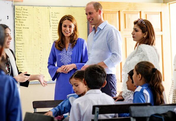 Kate Middleton wore a blue Kurta and trousers by Pakistani designer Maheen Khan and the Zeen earrings. Catherine Walker tunic