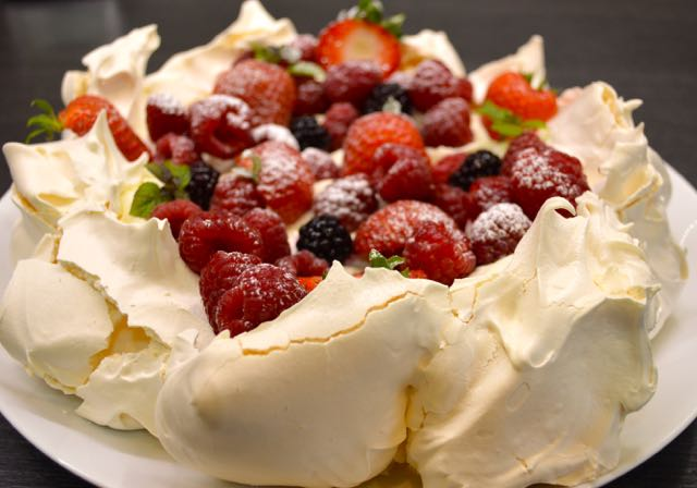 The finished summer berry pavlova