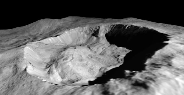 This view from NASA's Dawn mission shows where ice has been detected in the northern wall of Ceres' Juling Crater, which is in almost permanent shadow. Image credit: NASA/JPL-Caltech/UCLA/MPS/DLR/IDA/ASI/INAF