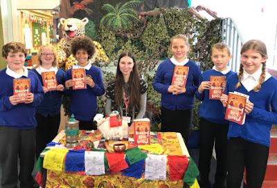 Jess Butterworth signing books for schoolchildren