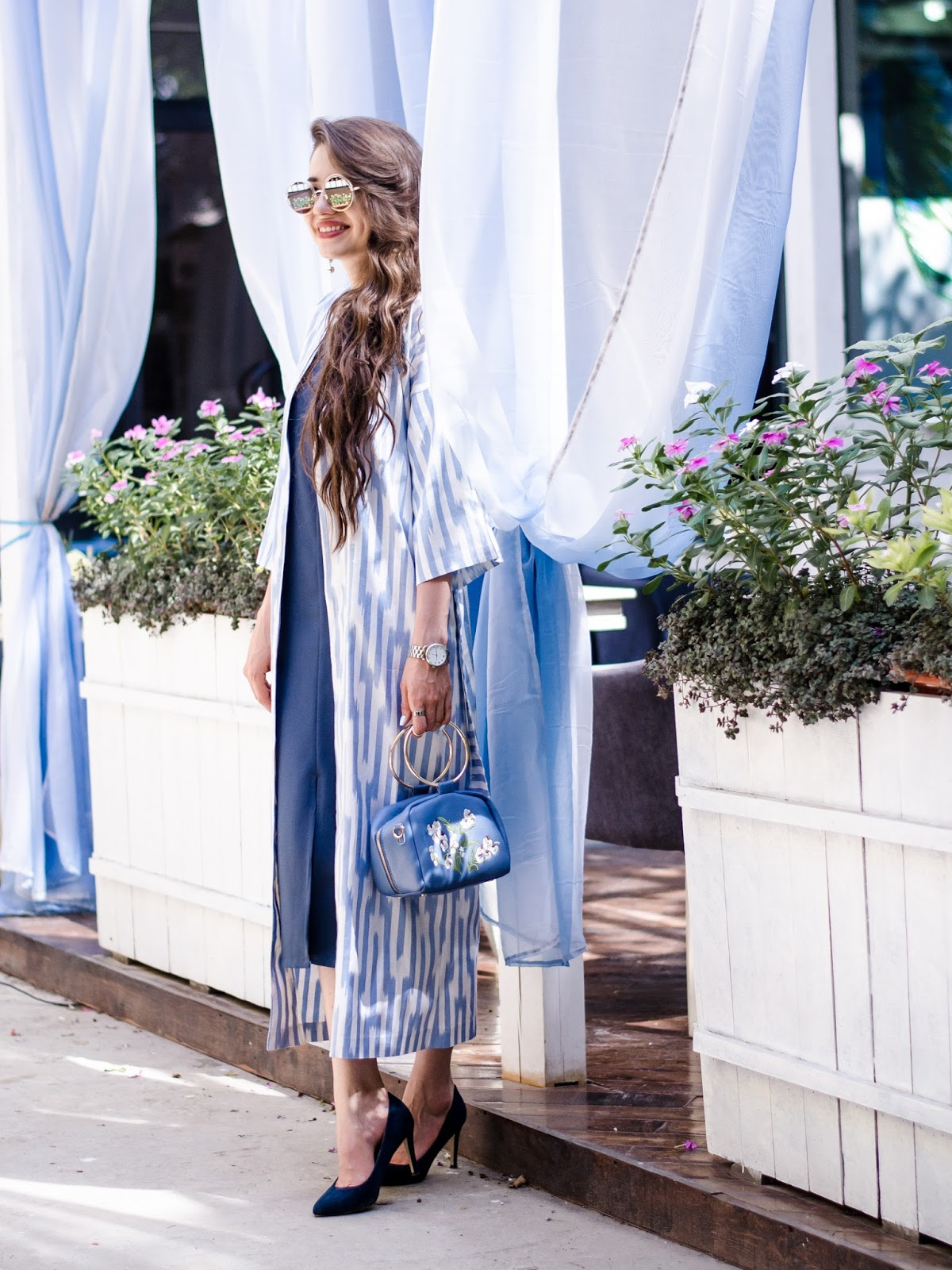 diyorasnotes diyora beta fashion blogger style outfitoftheday lookoftheday blue midi dress uzbek print embroidery bag