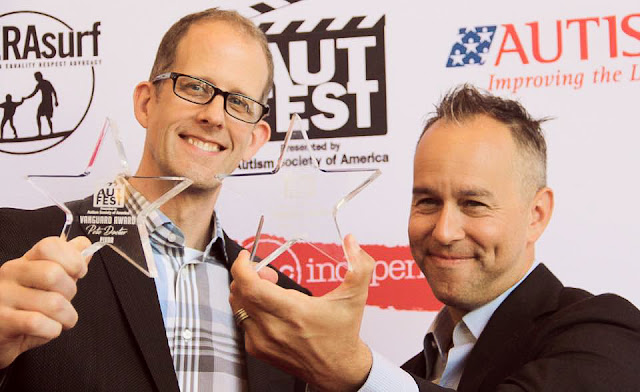Pete Docter and Jonas Rivera hold their AutFest Awards
