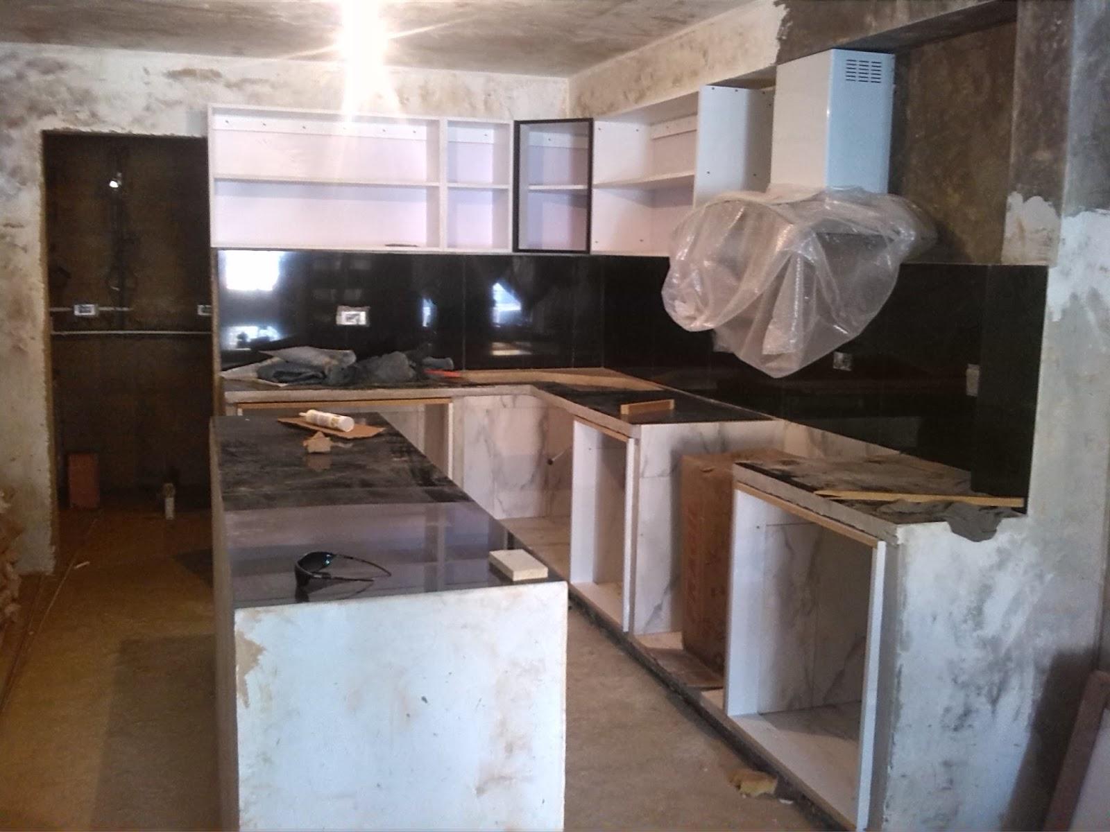 Arte y dise o cocina empotrada for Gabinetes en cemento