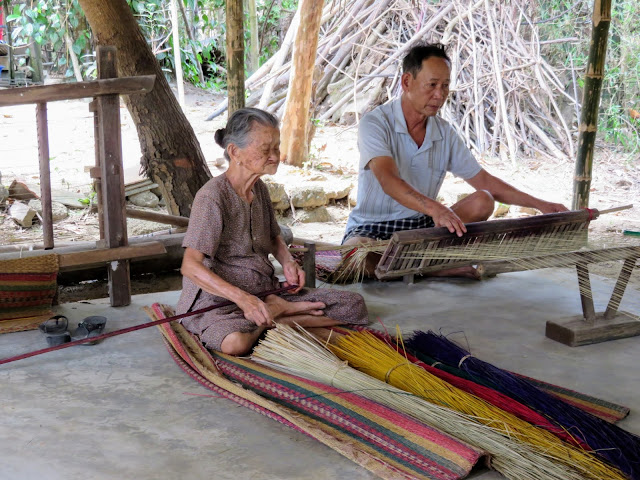 93 year old lady weaving sleeping mats near Hoi An Vietnam