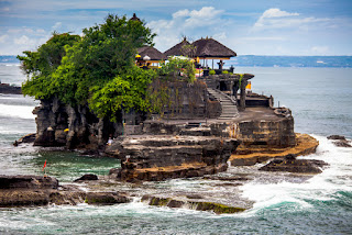 Pura Tanah Lot is a temple is located at the top of a large rock on the seafront
