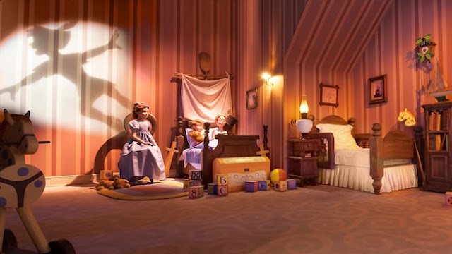 Interior of Peter Pan's flight ride, showing Wendy, Paul and Michael's in the nursery and Peter's shadow on the wall