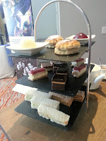 Cake stand with sandwiches and cakes
