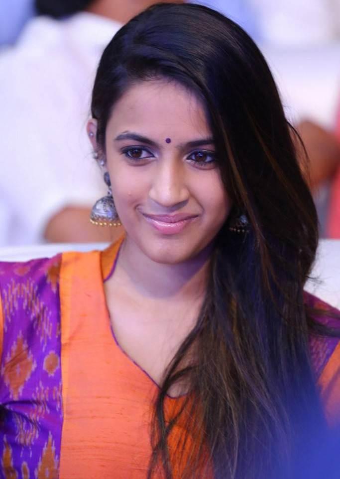 Niharika Stills In Orange Dress At Telugu Movie Pre Release Function