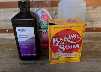 bottles of ingredients for skunk spray remover