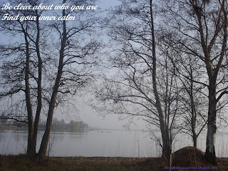 Image of looking through winter bare trees at a lake with text: Be clear about who you are, find your inner calm