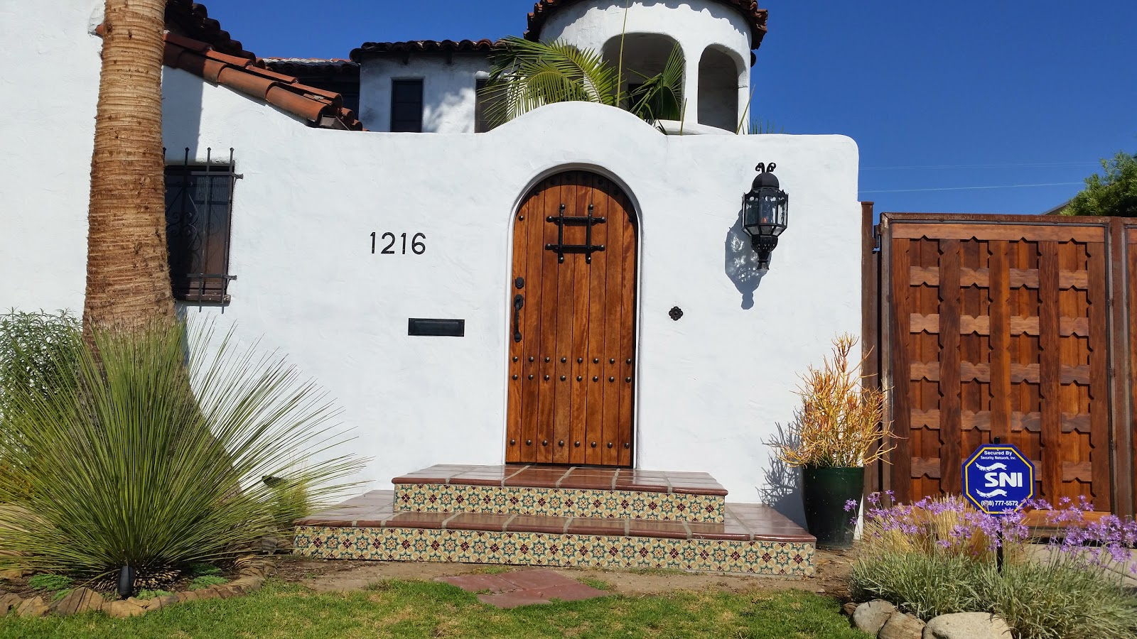 Spanish tile, wood and Moroccan detailing provide a provide a provide entry.